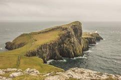 Neist Point Lighthouse on a rainy day. The Neist Point Lighthouse, in the most westerly point on Skye Island, Scotland Stock Image