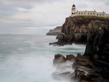 Neist Point Lighthouse. Waves crashing below the Lighthouse stock photos