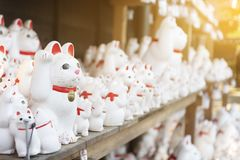 Neko cat cute statue inside the Neko temple. In Tokyo, Japan royalty free stock photo