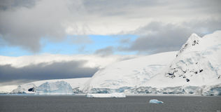 Neko Harbor and Patches of Blue. The Antarctic shores around Neko Harbor under a clearing sky Royalty Free Stock Photography