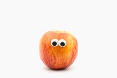 Nektaryna z googly oczami na białym tle Zdjęcie Royalty Free