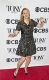Nell Benjamin. Lyricist Nell Benjamin appears to be doing a song and dance as she arrives for the 2018 Tony Awards Meet the Nominees press junket at the Royalty Free Stock Photography