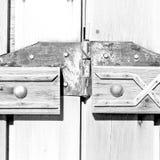 nella vecchia linea antica del fondo di struttura e dell'estratto della porta dell'Oman Fotografie Stock