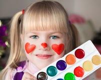 nelli ¡Cara, corazones rojos pintados! imagenes de archivo