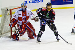Nelson Levi  of Renon Ritten Sport and Paul Dainton goalie  of HC Milano during a game Stock Photography
