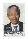 Nelson Mandela. President Nelson Mandela stamp becoming South African first black president, isolated on a white background