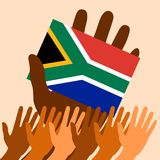 Nelson Mandela International Day. 18 July. Flag in hand of the Republic of South Africa. Raised Hands. Nelson Mandela International Day. 18 July. The concept of Stock Images