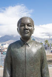 Nelson Mandela Statue. Statue of Nelson Mandela, first black president of RSA, in Cape Town, South Africa. The monument on Nobel Square show the Nobel Peace Royalty Free Stock Photo