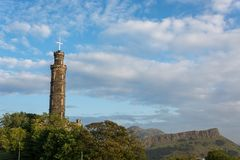 The Nelson monument on Calton Hill in Edinburgh with Arthurs Sea Royalty Free Stock Images