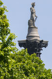 Nelson Statue on top of Nelsons Column in London Stock Image