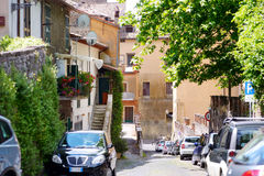 NEMI, ITALY - MAY 25, 2015:  Typical medieval narrow street in beautiful town of Nemi Royalty Free Stock Image
