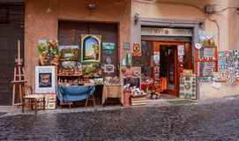 Nemi, ITALY - September 10, 2016: Showcase souvenir shop. Typical medieval narrow street in beautiful town of Nemi, Rome province,. Souvenirs, architecture Stock Photo