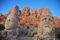 Nemrut Dagi at sunrise. Colossal statues on the top of Nemrut Dagi mountain. This tomb of the Commagene King Antiochus I is UNESCO world heritage site Stock Photography