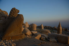 Nemrut statues in evening light. Some of the statues near the peak of Mount Nemrut (Turkey). West Terrace: lion and Greak Gods heads Stock Image