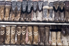 Nenets boots from deer fur are selling in the winter street Stock Images