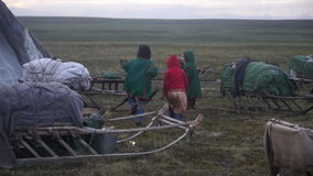 Nenets children play near the chum. The Yamal Peninsula. stock footage