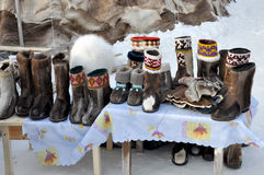 Nenets felt boots are selling in the winter street.  Royalty Free Stock Photo