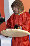 Nenets man shaman in the streen of north city. On the holiday Royalty Free Stock Photo