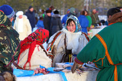 Nenets sell frozen fish and meat of deerh Stock Photography