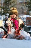 The Nenets woman holds deer meat in hand Stock Image