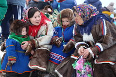 Nenets women with children talk to each other Stock Photos