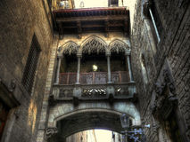 Neo-Gothic bridge and facade detail. In the Gothic quarter of Barcelona stock photography