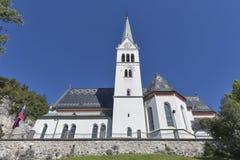 Neo gotisk kyrka av St Martin på Bled sjön, Slovenien Royaltyfri Foto