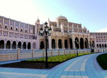 Neoclassic architecture style of institutional building at Sharja. Neoclassic architecture mid European style, elegant beige and white color of building, yellow Royalty Free Stock Photo