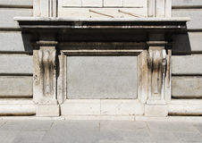 Neoclassic ashlar wall, high contrast. A detail of a neoclassic building, showing the base of a window, high contrast picture, landscape cut Royalty Free Stock Photography