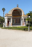Neoclassic building, palermo. Overall view of one of the neoclassic exedras of villa giulia gardens, with the acroteria shaped as greek theater masks, palermo Royalty Free Stock Photography
