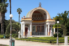 Neoclassic building, palermo. Overall view of one of the neoclassic exedras of villa giulia gardens, with the acroteria shaped as greek theater masks, palermo Stock Images