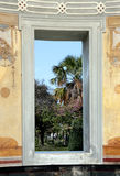 Neoclassic building, palermo. View of the palms and trees of the gardens villa giulia through a window of one of  the neoclassic exedras, palermo, sicily Stock Photography