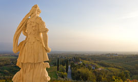 Neoclassic Statue. Facing a country landscape Stock Image