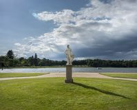 Neoclassic Statue at Rheinsberg Palace. Neoclassic Statue in the Lustgarten at Rheinsberg Palace, in front of the lake Grienericksee Stock Photo