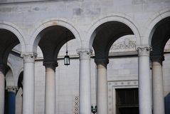 Neoclassical Arches at the Los Angeles City Hall. A shot of the neoclassical arches, supported by corinthian pillars at the base of the Los Angeles city hall royalty free stock images