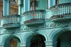 Neoclassical architecture in mint green. Neoclassical balcony with column in mint green in Old Havana in Cuba royalty free stock image