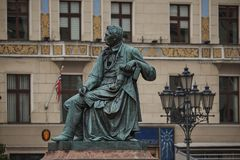 Neoclassical bronze statue of famous Polish writer Alexander Fredro, 1897, by Leonard Marconi, Wroclaw`s main market square Royalty Free Stock Photography