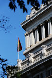 Neoclassical building and flag of spain, madrid Royalty Free Stock Photos