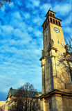 Neoclassical campanile with statues and clock Stock Images
