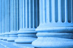 Neoclassical columns blue - business concept. Neoclassical columns of Museum of Fine Arts, Budapest, in business blue - business concept royalty free stock photo