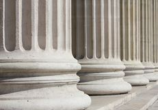 Neoclassical columns closeup - business concept Royalty Free Stock Photo