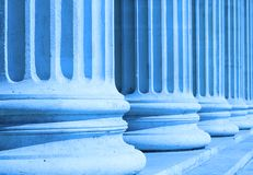 Neoclassical columns closeup blue - business concept stock photo