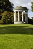 Neoclassical Garden Rotunda 2. The expansive grounds of an ancestral English country estate with an ornamental rotunda among mature autumn trees in a vertical Royalty Free Stock Photos