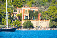 Neoclassical villa. Architecture, by the sea, on an island in Greece stock photos