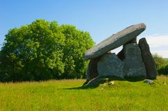 Neolithic burial chamber. This well-preserved and impressive Neolithic 'dolmen' burial chamber stands 2.7 metres (8.9 ft) high. There are five standing stones Royalty Free Stock Image