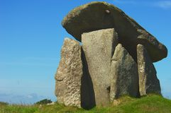 Neolithic burial chamber. This well-preserved and impressive Neolithic 'dolmen' burial chamber stands 2.7 metres (8.9 ft) high. There are five standing stones Royalty Free Stock Images