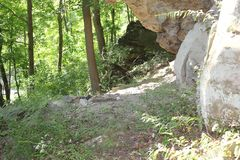 Neolithic cave formation at Meadowcroft rockshelter. Meadowcroft rockshelter is an archaeological site located west-southwest of Pittsburgh Pennsylvania royalty free stock photography