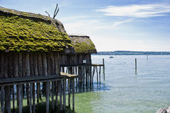 Neolithic Dwelling. Rebuilt neolithic setllement; Bodensee Germany; Building on stilts Royalty Free Stock Image
