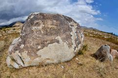 Neolithic petroglyphs rock paintings depicting fighting of two mountain goats,Issyk-Kul lake, Kyrgyzstan,Central Asia stock photo