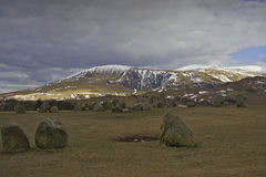 Neolithic rocks in Cumbria - towards Skiddaw. In the English Lake District: megaliths in the Castlerigg stone circle with looking west towards Skiddaw. One of Royalty Free Stock Images